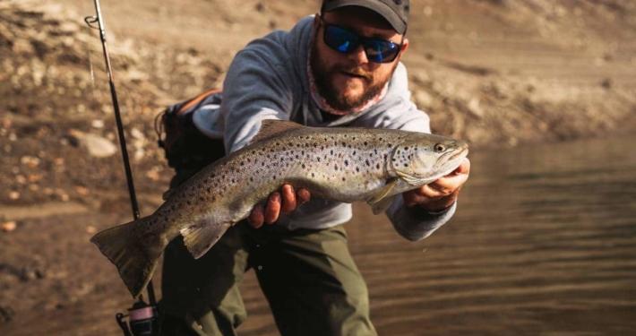big brown trout from lokve lake in croatia caught by Robert Pljuscec of sakura fishing team