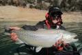Loic Domergue du team sakura avec sa premiere truite lacustre